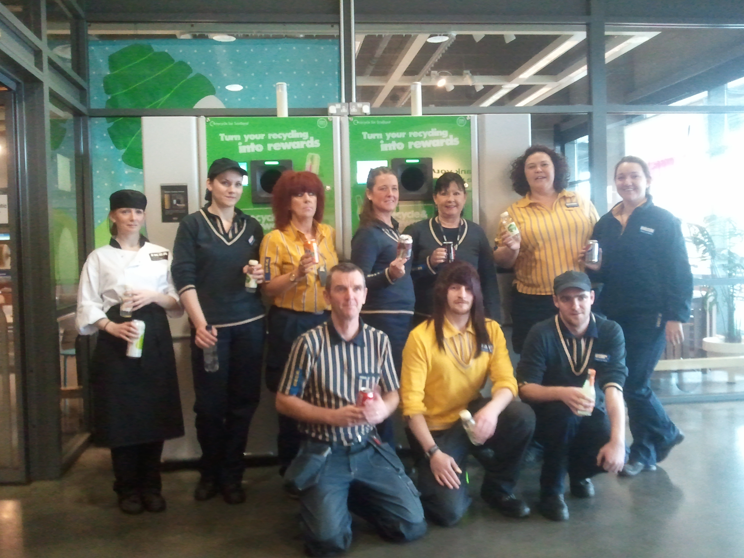 Image of IKEA Glasgow co-workers in front of their Reverse Vending Machine.